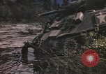Image of U.S. troops ride on tanks crossing a stream Germany, 1945, second 32 stock footage video 65675076625