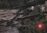 Image of U.S. troops ride on tanks crossing a stream Germany, 1945, second 33 stock footage video 65675076625