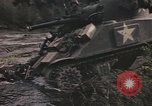 Image of U.S. troops ride on tanks crossing a stream Germany, 1945, second 34 stock footage video 65675076625