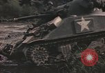 Image of U.S. troops ride on tanks crossing a stream Germany, 1945, second 35 stock footage video 65675076625