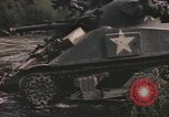Image of U.S. troops ride on tanks crossing a stream Germany, 1945, second 36 stock footage video 65675076625