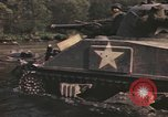 Image of U.S. troops ride on tanks crossing a stream Germany, 1945, second 41 stock footage video 65675076625