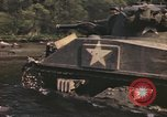 Image of U.S. troops ride on tanks crossing a stream Germany, 1945, second 42 stock footage video 65675076625