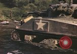 Image of U.S. troops ride on tanks crossing a stream Germany, 1945, second 43 stock footage video 65675076625