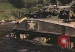 Image of U.S. troops ride on tanks crossing a stream Germany, 1945, second 44 stock footage video 65675076625