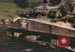 Image of U.S. troops ride on tanks crossing a stream Germany, 1945, second 45 stock footage video 65675076625