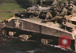 Image of U.S. troops ride on tanks crossing a stream Germany, 1945, second 46 stock footage video 65675076625