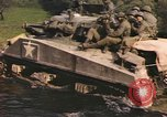 Image of U.S. troops ride on tanks crossing a stream Germany, 1945, second 47 stock footage video 65675076625