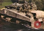 Image of U.S. troops ride on tanks crossing a stream Germany, 1945, second 48 stock footage video 65675076625