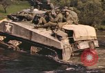 Image of U.S. troops ride on tanks crossing a stream Germany, 1945, second 49 stock footage video 65675076625