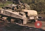 Image of U.S. troops ride on tanks crossing a stream Germany, 1945, second 50 stock footage video 65675076625