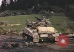 Image of U.S. troops ride on tanks crossing a stream Germany, 1945, second 53 stock footage video 65675076625
