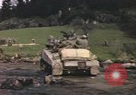 Image of U.S. troops ride on tanks crossing a stream Germany, 1945, second 54 stock footage video 65675076625