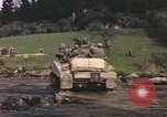 Image of U.S. troops ride on tanks crossing a stream Germany, 1945, second 55 stock footage video 65675076625