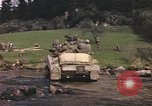 Image of U.S. troops ride on tanks crossing a stream Germany, 1945, second 56 stock footage video 65675076625