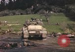 Image of U.S. troops ride on tanks crossing a stream Germany, 1945, second 57 stock footage video 65675076625