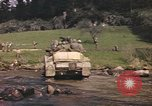 Image of U.S. troops ride on tanks crossing a stream Germany, 1945, second 58 stock footage video 65675076625