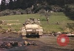 Image of U.S. troops ride on tanks crossing a stream Germany, 1945, second 59 stock footage video 65675076625