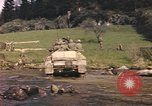 Image of U.S. troops ride on tanks crossing a stream Germany, 1945, second 60 stock footage video 65675076625