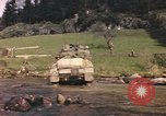 Image of U.S. troops ride on tanks crossing a stream Germany, 1945, second 61 stock footage video 65675076625