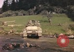 Image of U.S. troops ride on tanks crossing a stream Germany, 1945, second 62 stock footage video 65675076625