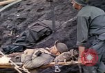 Image of wounded Marine Iwo Jima, 1945, second 15 stock footage video 65675077474