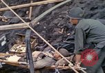 Image of wounded Marine Iwo Jima, 1945, second 16 stock footage video 65675077474