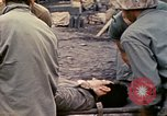Image of wounded Marine Iwo Jima, 1945, second 40 stock footage video 65675077474