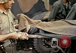Image of wounded Marine Iwo Jima, 1945, second 54 stock footage video 65675077474