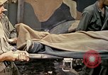 Image of wounded Marine Iwo Jima, 1945, second 55 stock footage video 65675077474