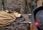 Image of wounded Marine Iwo Jima, 1945, second 62 stock footage video 65675077474